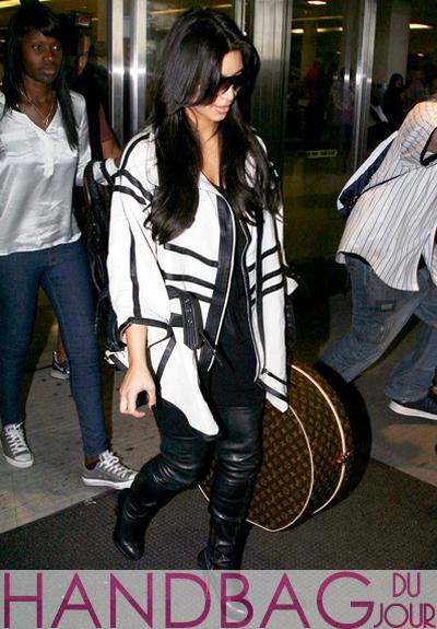 Kim Kardashian arrived at JFK International Airport with sister Kourtney, Scott Disick and Mason Dash Disick, carrying the Louis Vuitton Boite Chapeaux Monogram Hat Box