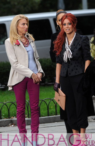 Debbie-Gibson-and-Aubrey-O'Day-on-the-set-of-Celebrity-Apprentice-in-New-York-City-pink-envelope-clutch