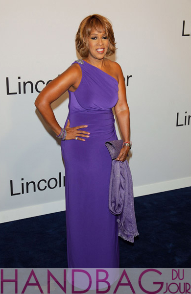 Gayle-King-at-Evening-with-Ralph-Lauren-hosted-by-Oprah-Winfrey-at-Alice-Tully-Hall,-Lincoln-Center-New-York-City-purple-VBH-envelope clutch