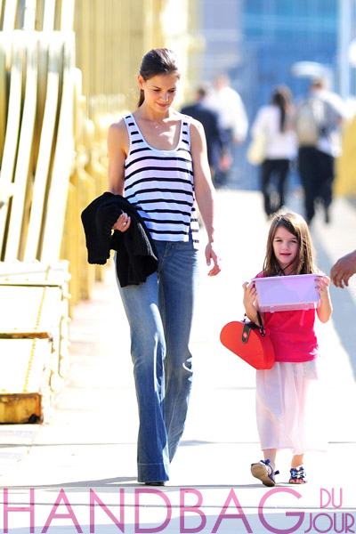 Katie-Holmes-and-Suri-Cruise-pink plastic toy handbag seen-on-the-streets-of-Pittsburgh-on-October-6,-2011-in-Pittsburgh,-Pennsylvania