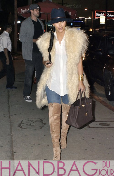 Kim Kardashian heads out for dinner at Izakaya in West Hollywood last night with hubby Kris Humphries wearing designer Jahaanara Gilet's Lamb Fur Vest in vanilla and carrying a chocolate brown colored Birkin bag