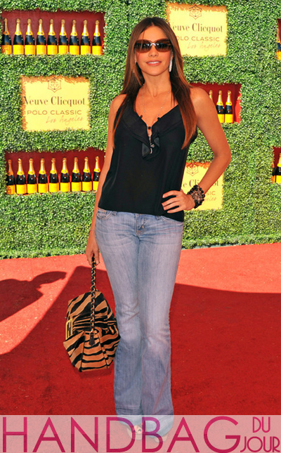 Sofia Vergara attended the Veuve Clicquot Polo Classic dressed casually in jeans and a tank top, accessorized with Jewels By Dunn bracelets and a Fendi Zebra-Print Calf Hair Chain Handle Baguette