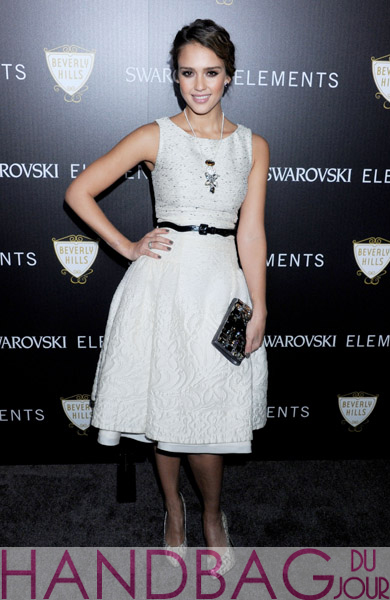Actress-Jessica-Alba-arrives-at-the-Swarovski-Elements-And-Rodeo-Drive-Lighting-Ceremony-on-November-21,-2011-in-Beverly-Hills,-California with a Swarovski clutch