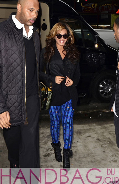 Beyonce was spotted in New York dressed in a Rick Owens leather jacket, blue Ikat print leggings from ASOS, Balmain lace up boots and carrying a bowler-style Burberry Prorsum Resort 2012 woven raffia and calfskin leather bag