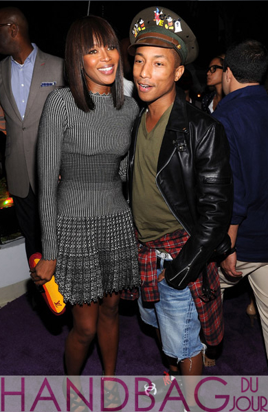 Naomi-Campbell-and-Pharrell-Williams-attend-The-Kingdom-of-Morocco-and-Maybach-dinner-in-celebration-of-Art-Basel-at-Raleigh-Hotel-in-Miami-Beach,-Florida-red-orange-yellow-Louis-Vuitton-clutch