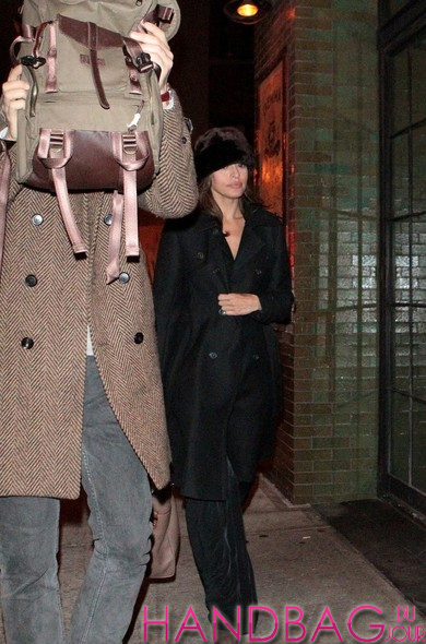 Guess the celebrity couple behind the duffel bag ...
