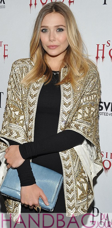 Elizabeth Olsen at the 'Silent House' premiere with The Row Metal framed lizard clutch