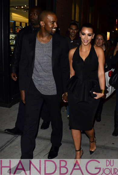 Kanye West in a black suit with Kim Kardashian in a black Givenchy Peplum and Ruffle cocktail dress Christian Louboutin Un Bout transparent PVC pointed-toe pumps and a Bottega Veneta Knot Intreccio Memory Clutch