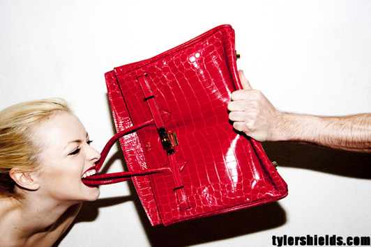 Francesca Eastwood with a 100,000 red crocodile Birkin in her teeth
