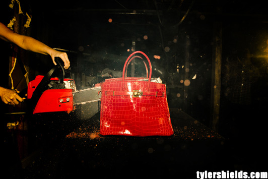 Francesca Eastwood with a chainsaw to the 100,000 red crocodile Birkin