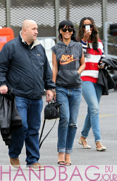 Rihanna in Joyrich Rich cutoff hoodie, Ray-Ban Icons Wayfarer sunglasses, boyfriend jeans, Manolo Blahnik strappy sandals, Celine Mini Luggage Bag, Melissa in Valentino python Rockstud flats