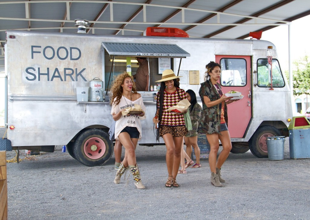 Beyonce, Solange and friend in Texas in a Wildfox Couture Property of Texas T-shirt and Big Buddha Wayne Western boots