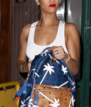 Celebrity Handbag Spotting: Rihanna with MCM Bicolor Palmtree-Printed Coated Canvas Backpack