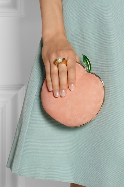 Charlotte Olympia What A Peach suede clutch closeup hand