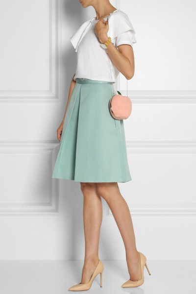 Charlotte Olympia What A Peach suede clutch on model