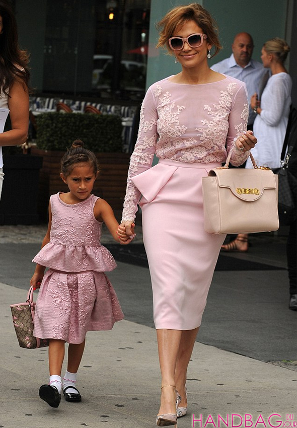 Jennifer Lopez and Emme look pretty in pink with Versace padlock fastening tote and Gucci Zoo tote bags
