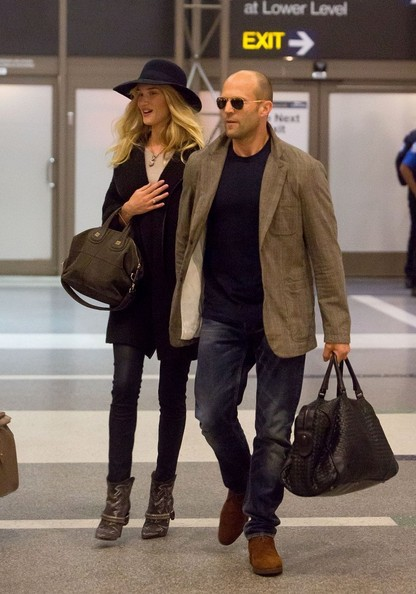 Rosie Huntington-Whiteley and Jason Statham with Bottega Veneta Nero Intrecciato VN Large Duffel