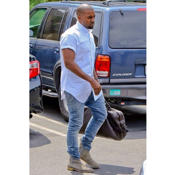 Celebrity Manbag: Kanye West totes a $4K Bottega Veneta bag - Bottega Veneta Nero Intrecciato VN Large Duffel - 2014 Outside Lands Music Festival