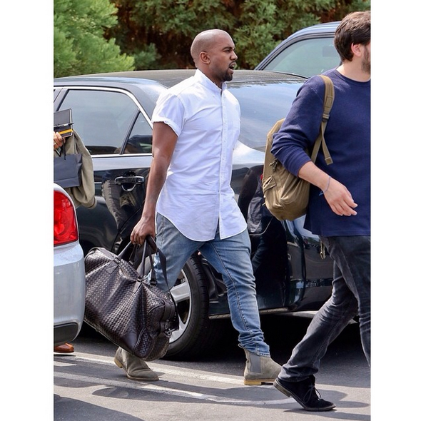 Kanye West with Bottega Veneta Nero Intrecciato VN Large Duffel - 2014 Outside Lands Music Festival