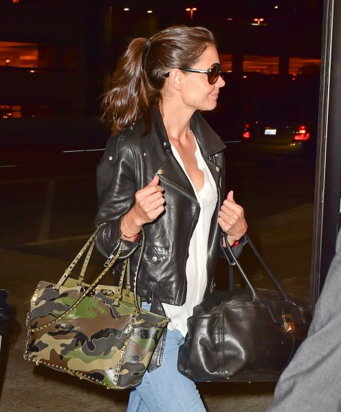 Katie Holmes double bags it with Lanvin and Valentino (Rockstud Camo Canvas-Leather Medium Tote Bag and JL Bowling Bag) at LAX