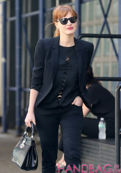 Jessica Chastain with Gucci Lady Lock Top Handle Bag