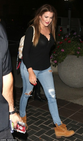 Khloe Kardashian with Chanel Large Graffiti Printed Canvas Backpack embellished with multicolored ropes